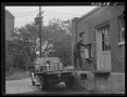 1941-Farmer-getting-his-empty-milk-cans-back-at-the-Burlington-cooperative-milk-bottling-plant.-Burlington-Vermont